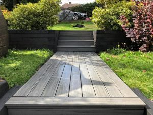 Grey trex deck used as a path and steps in a garden