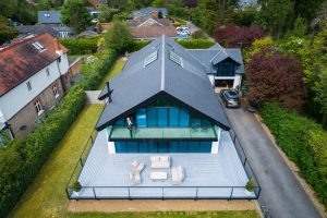 Drone shot of decking attached to house with railings