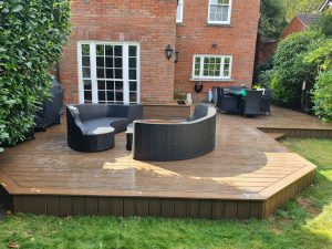 Raised Trex deck with sofa and dining table