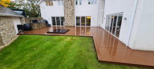 L shape Trex decking attached to the house