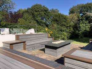 Seating area and fire pit created with Trex deck boards