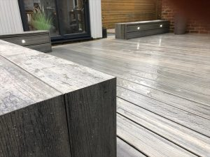 Close-up of Trex Island Mist deck boards used for seating