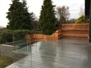 Trex Island Mist decking with clear glass railings