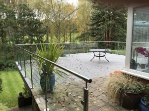 Trex decking used on balcony with clear glass railings