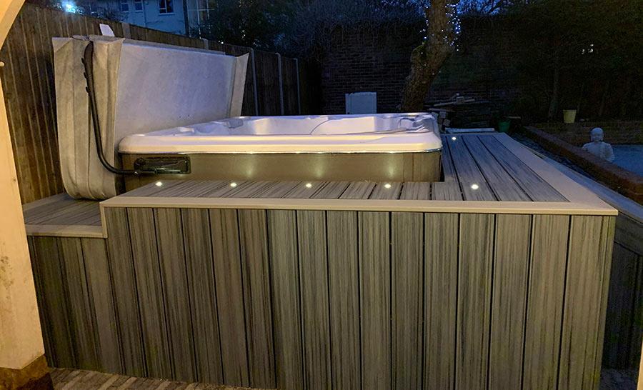 Trex Island Mist deck surrounding a hot tub