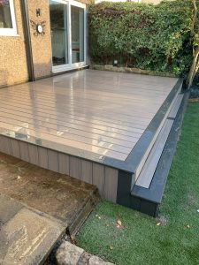 Small raised Trex deck with a large step