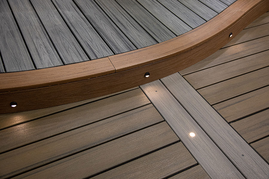 Curved Trex deck step with spotlights