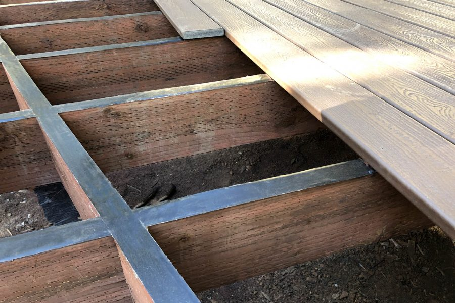 Trex protect on top of timber joists.