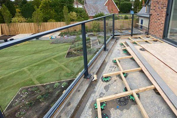 Aluminium glass railing with a timber frame
