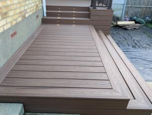 Brown Trex deck with spotlights in steps