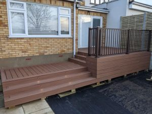 Brown Trex decking with feature steps and integrated spotlights