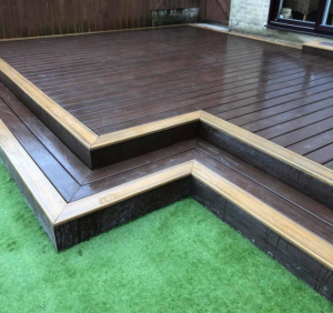 Brown Trex decking with step down to grass