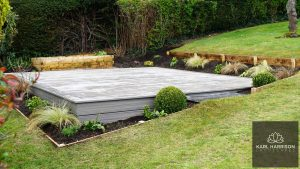 Grey Trex deck surrounded by planting area