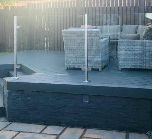 Grey Trex deck with glass railing