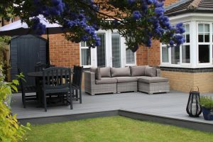 Grey Trex deck with sofa and dining area