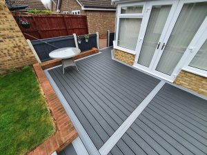 Grey Trex decking with table