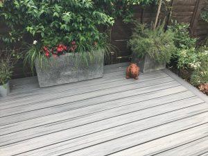 Grey Trex deck with planters