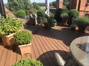 Brown Trex deck with plant pots