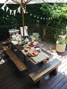 Trex deck with dining table and benches