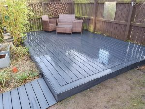 Small grey Trex deck with seating