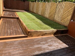 Multi-level Trex deck in brown with grass area